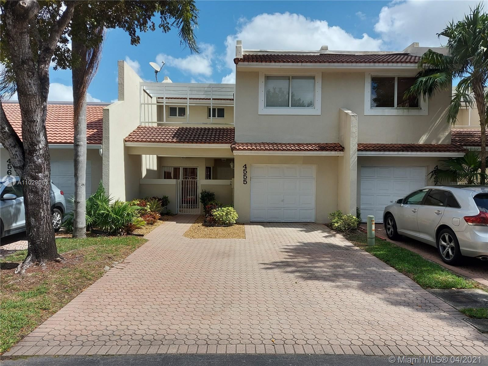 Photo of 4555 NW 98th Ave #4555, Doral, FL 33178 (MLS # A11029063)