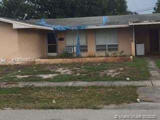 Photo of 3850 NW 7th St, Lauderhill, FL 33311 (MLS # A10694067)