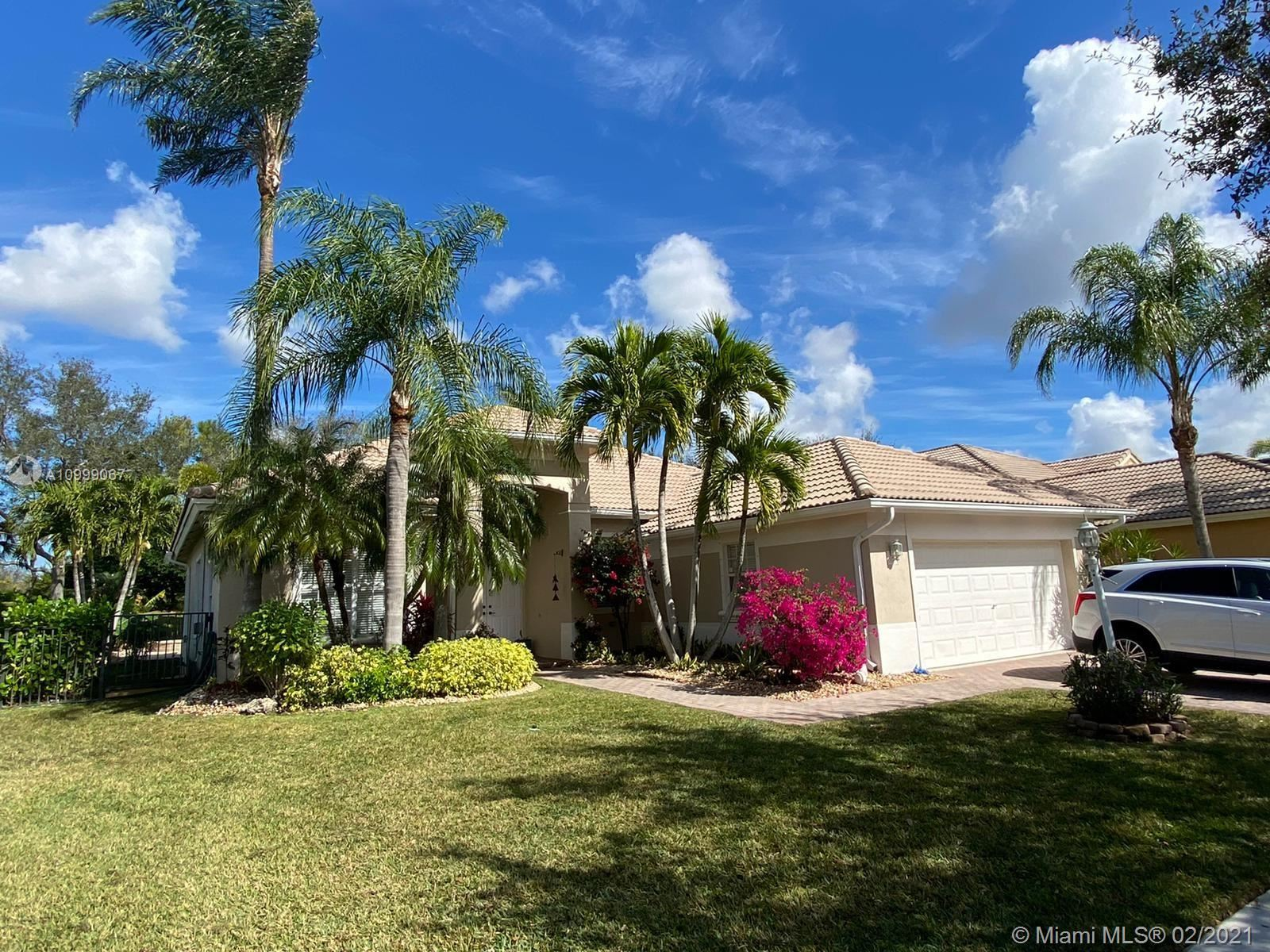 Photo of 11295 NW 71st Ct, Parkland, FL 33076 (MLS # A10999067)
