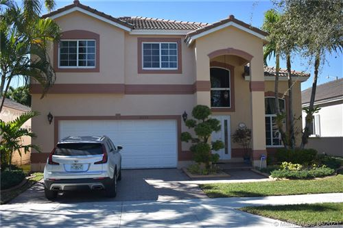 Photo of 5424 NW 111th Ct, Doral, FL 33178 (MLS # A11043068)