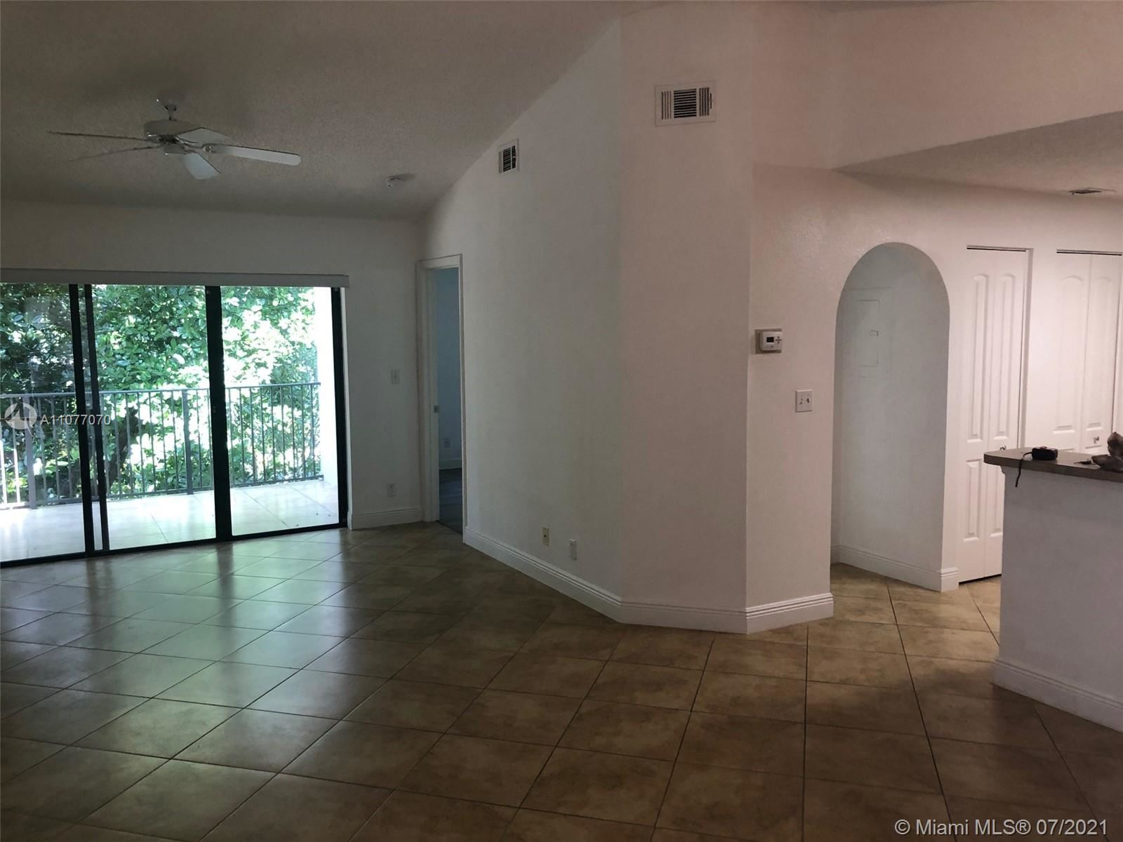Photo of 10155 W Sunrise Blvd #304, Plantation, FL 33322 (MLS # A11077070)