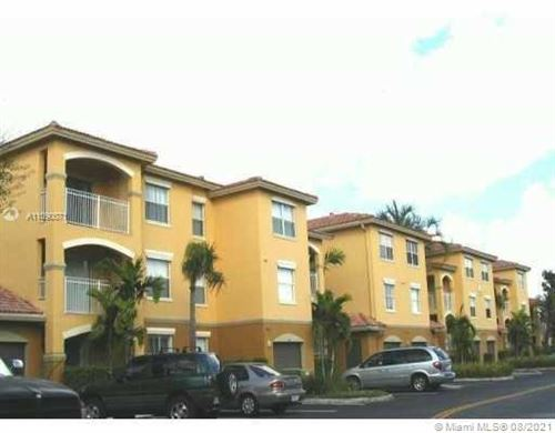 Photo of 9650 NW 2nd St #4-105, Pembroke Pines, FL 33024 (MLS # A11090071)