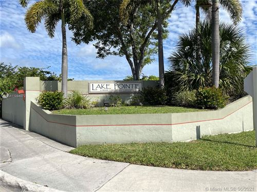 Photo of 214 LAKE POINTE DR #202, Oakland Park, FL 33309 (MLS # A11054072)