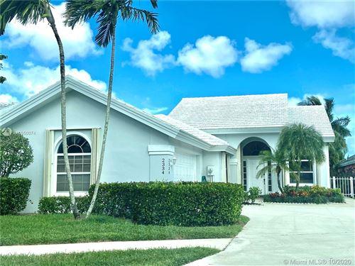 Photo of 2334 Saratoga Bay Dr, West Palm Beach, FL 33409 (MLS # A10950074)