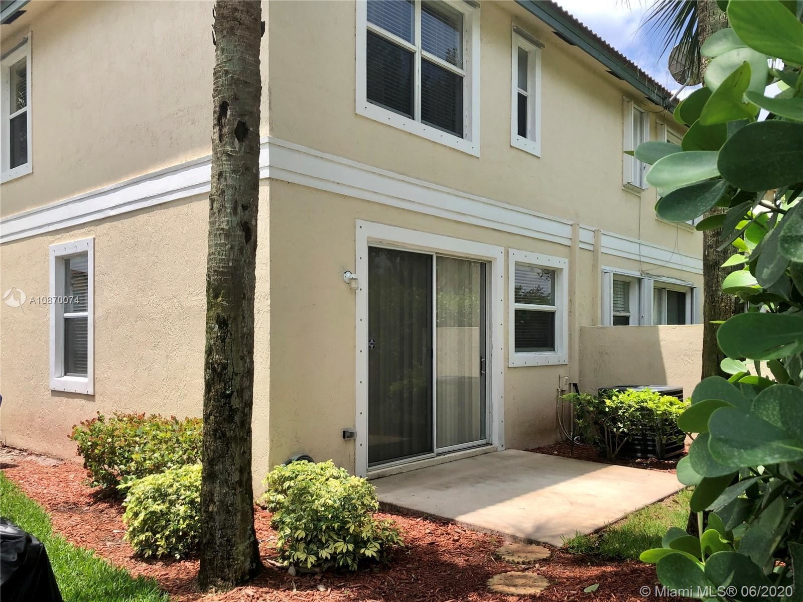 Photo of 11701 NW 47th Dr #1-1, Coral Springs, FL 33076 (MLS # A10870074)