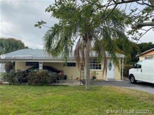 Photo of 1549 W 32nd St, Riviera Beach, FL 33404 (MLS # A11017077)