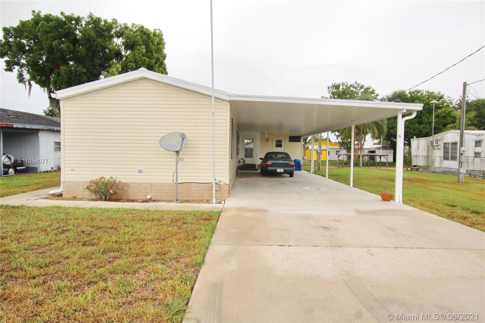 1039 Lime Street, Okeechobee, FL 34974 - #: A11054077