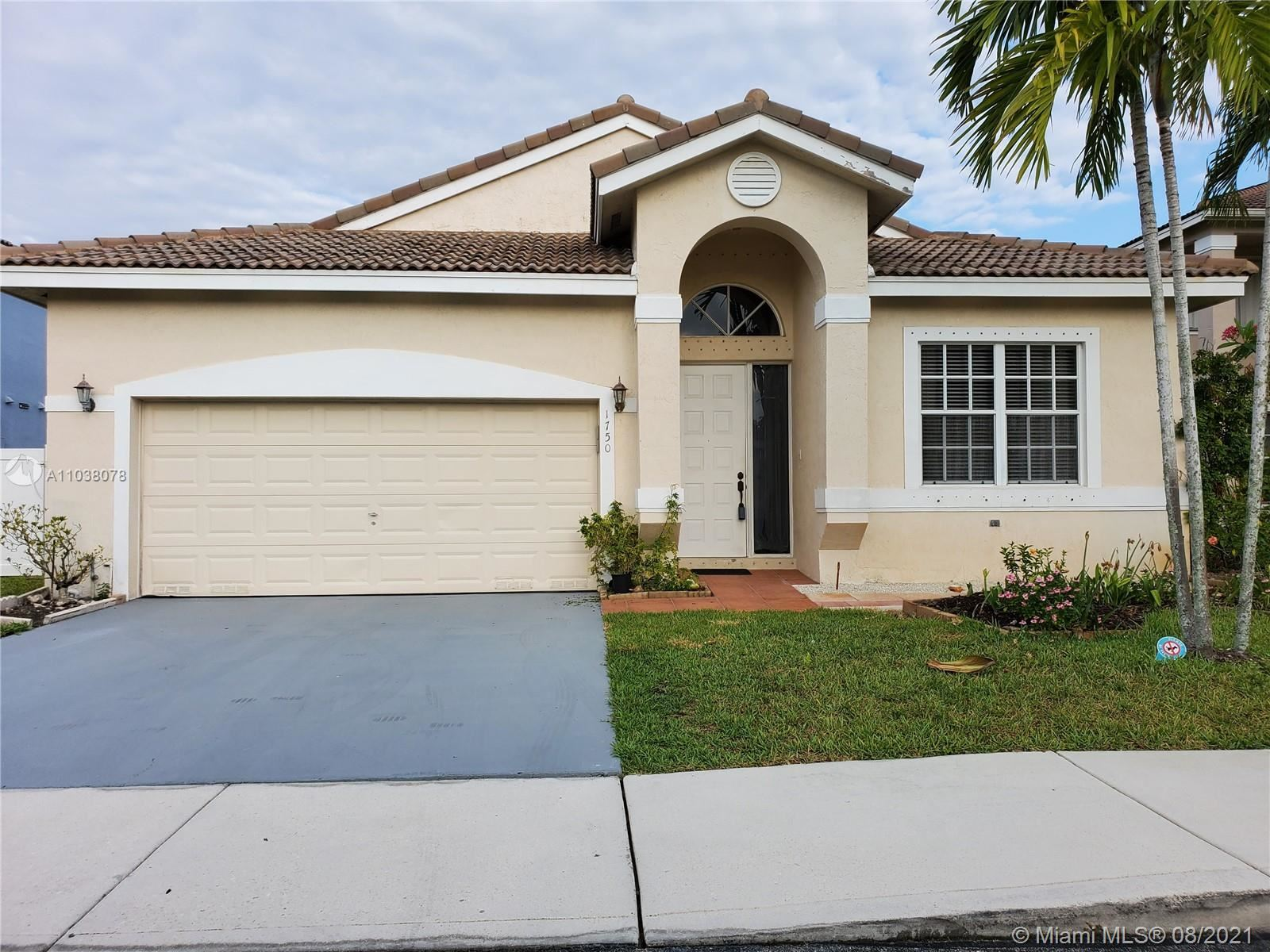 Photo of 1750 NW 165th Ave, Pembroke Pines, FL 33028 (MLS # A11038078)