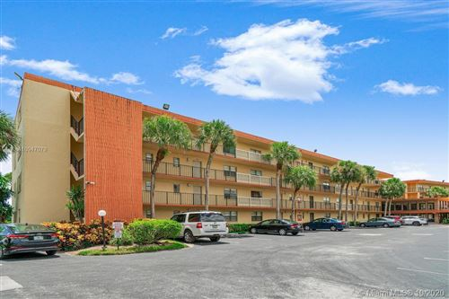 Photo of 9440 SW 8th St #402, Boca Raton, FL 33428 (MLS # A10947079)