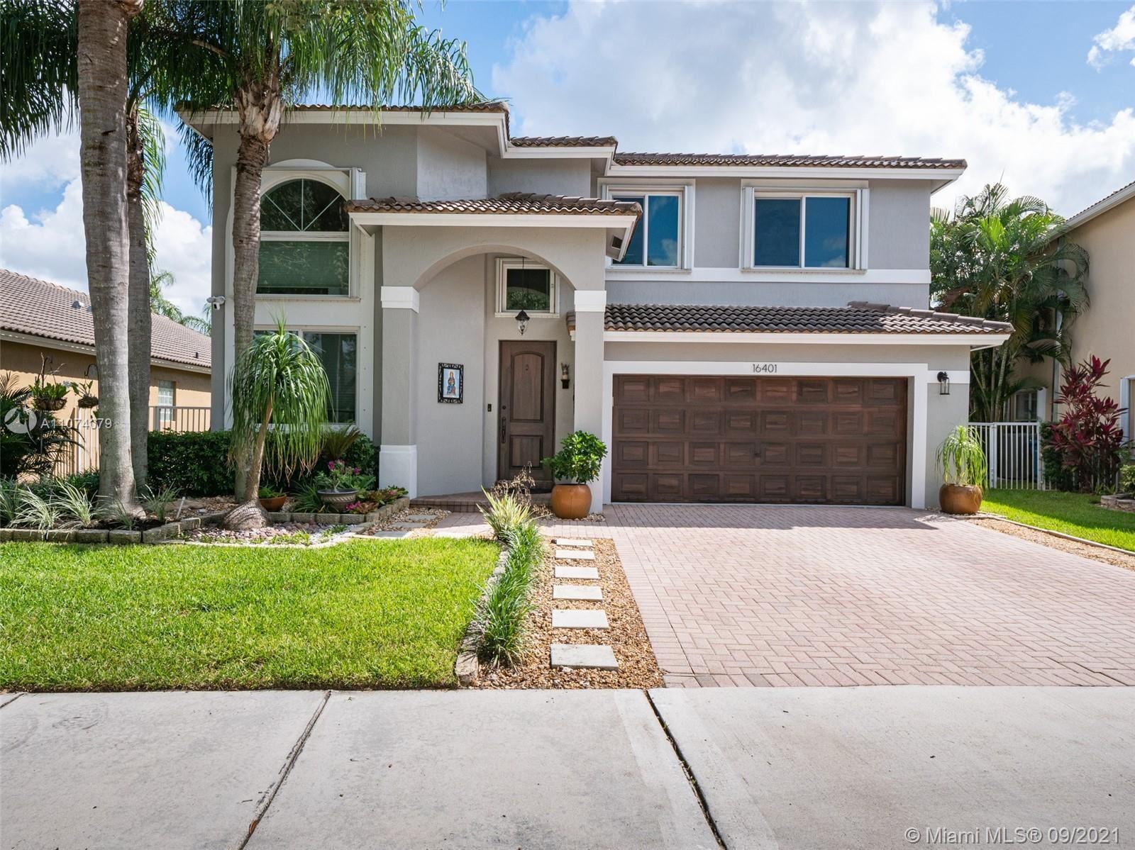 Photo of 16401 Turquoise Trl, Weston, FL 33331 (MLS # A11074079)