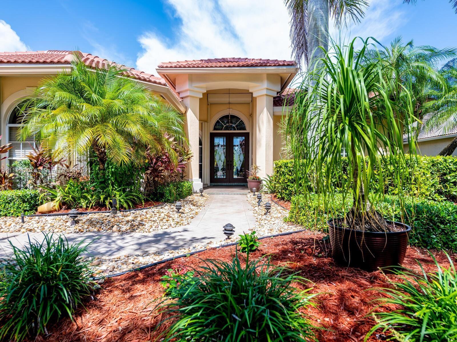 Photo of 305 Egret Ln, Weston, FL 33327 (MLS # A11112079)