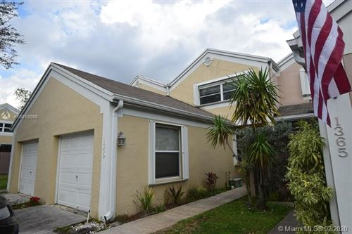 Photo of 1369 NW 123rd Ter, Pembroke Pines, FL 33026 (MLS # A10818080)