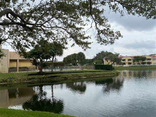 Photo of 8592 W Sunrise Blvd #104, Plantation, FL 33322 (MLS # A11116081)