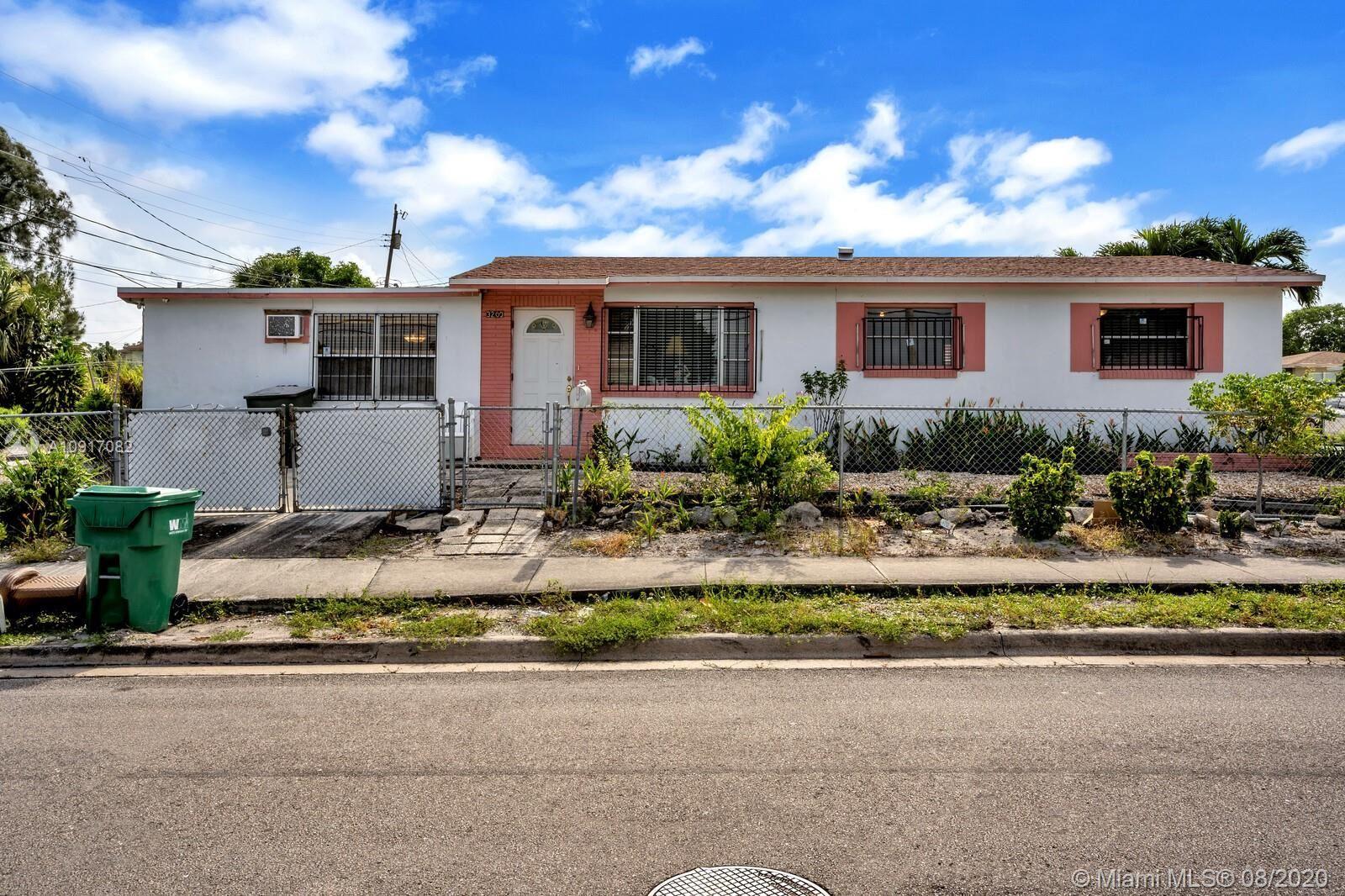 Photo of 3200 Avenue O, Riviera Beach, FL 33404 (MLS # A10917082)