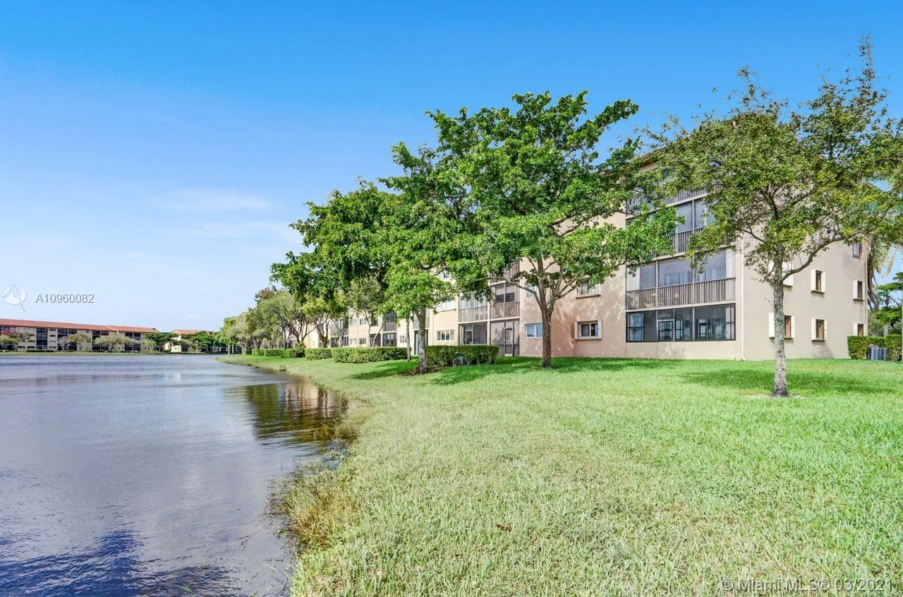 Photo of 13700 SW 14th St #208D, Pembroke Pines, FL 33027 (MLS # A10960082)