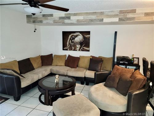 Photo of 9717 NW 23rd Ct #9717, Pembroke Pines, FL 33024 (MLS # A11074084)
