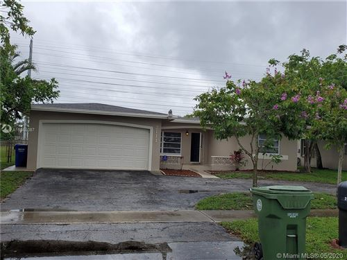 Photo of 2111 NW 93rd Ave, Pembroke Pines, FL 33024 (MLS # A10865087)