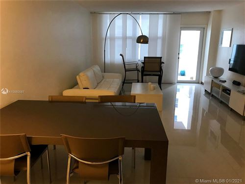 Photo of 9225 Collins Ave #810, Surfside, FL 33154 (MLS # A10980087)