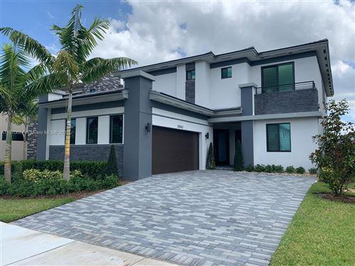 Photo of 10940 Vista Ter, Parkland, FL 33076 (MLS # A11070087)