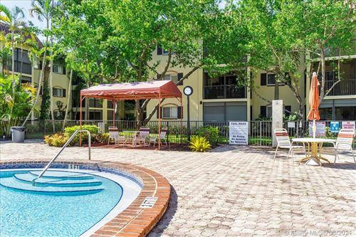 Photo of 255 S Cypress Rd #306, Pompano Beach, FL 33060 (MLS # A11072088)