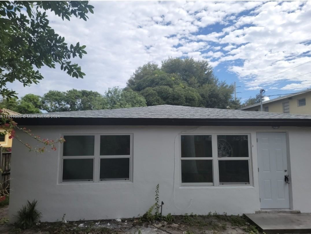 Photo of 508 NW 8th Ave, Fort Lauderdale, FL 33311 (MLS # A11111089)