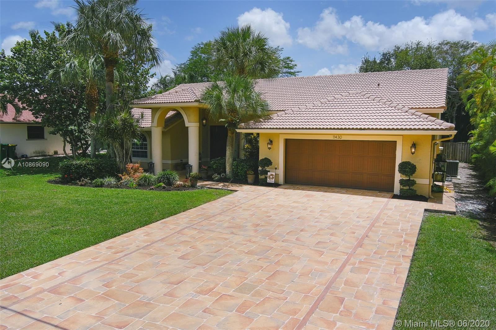 Photo of 11430 NW 23rd St, Plantation, FL 33323 (MLS # A10869090)