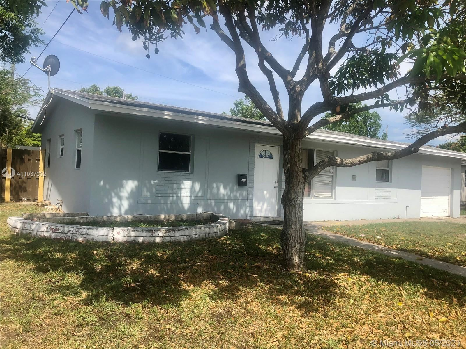 Photo of 1311 NW 50th Ave, Lauderhill, FL 33313 (MLS # A11037092)