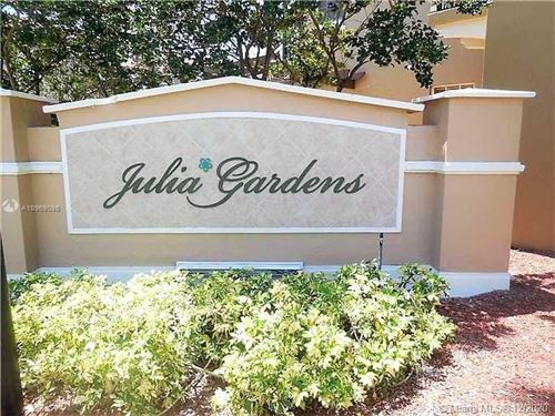 Photo of 6875 Julia Gardens Dr, Coconut Creek, FL 33073 (MLS # A10969096)