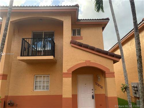 Photo of 10676 NW 87th Ct #10676, Hialeah Gardens, FL 33018 (MLS # A10960097)