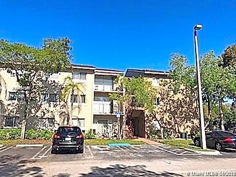 Photo of 1080 N Benoist Farms Rd #207, West Palm Beach, FL 33411 (MLS # A10891100)