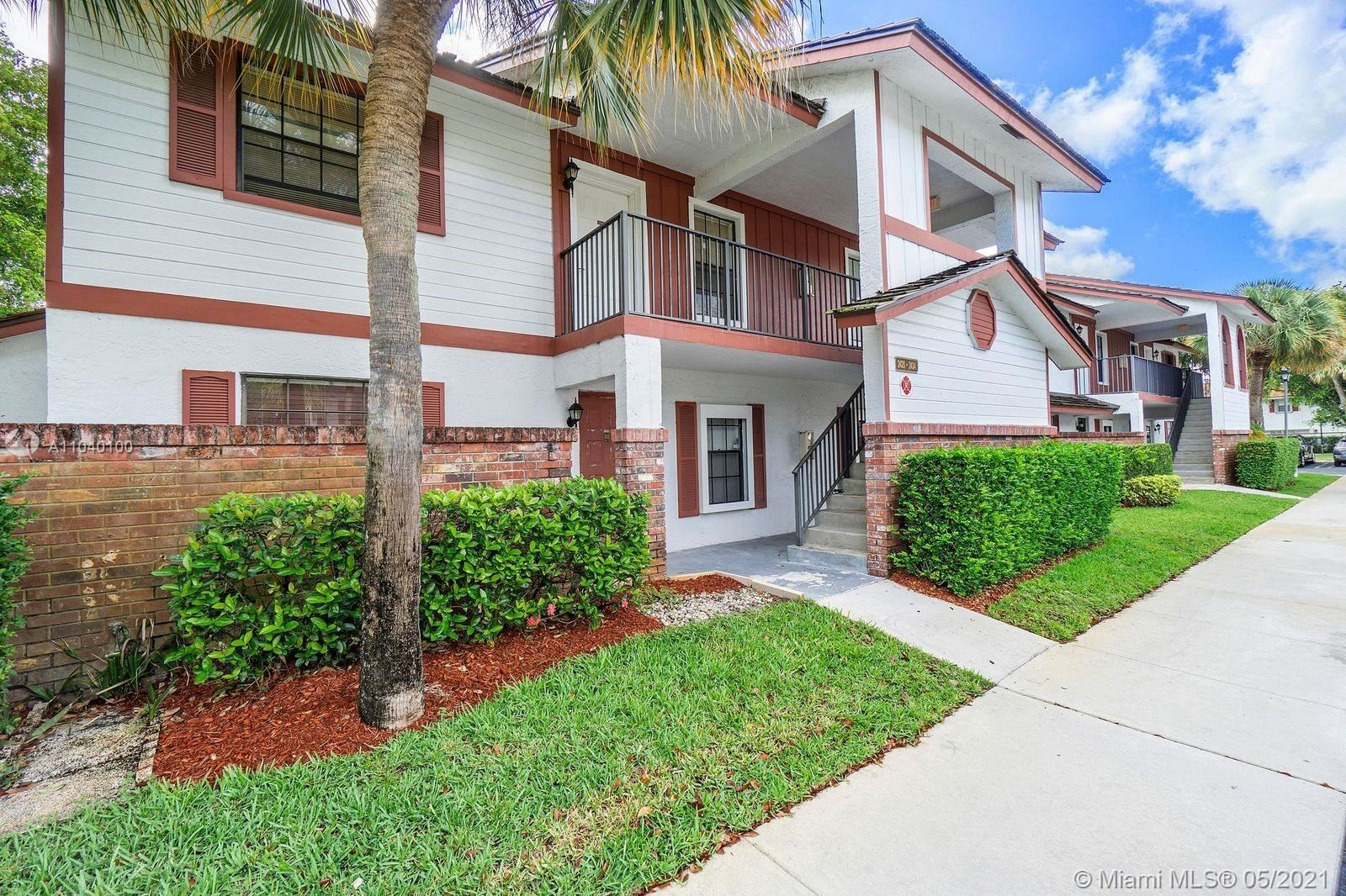 Photo of 2430 NW 89th Dr #2430, Coral Springs, FL 33065 (MLS # A11040100)