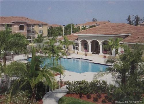 Photo of 6466 Emerald Dunes Dr #208, West Palm Beach, FL 33411 (MLS # A10937103)