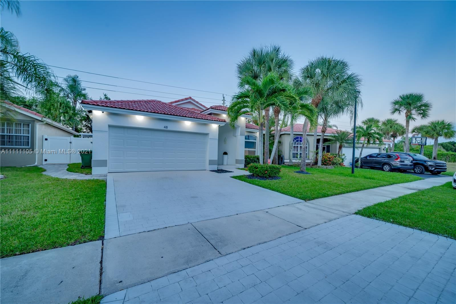 Photo of 48 Gables Blvd, Weston, FL 33326 (MLS # A11111105)