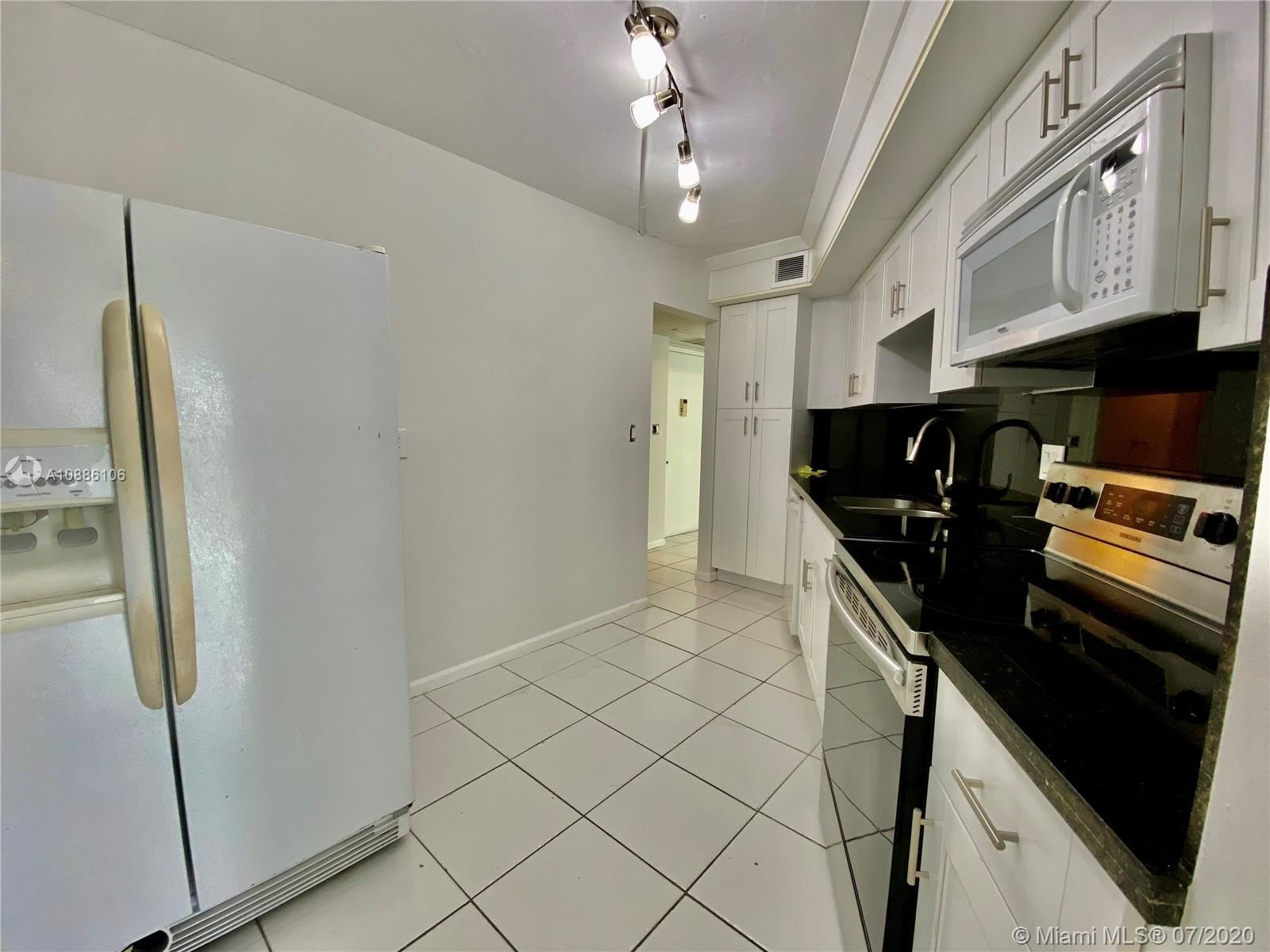 Photo of 6921 Environ Blvd #2P, Lauderhill, FL 33319 (MLS # A10886106)