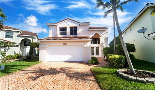 Photo of 11047 NW 34th Mnr, Coral Springs, FL 33065 (MLS # A11078108)