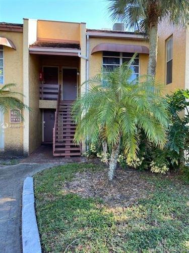 Photo of 4521 Treehouse Ln #F, Tamarac, FL 33319 (MLS # A10989110)
