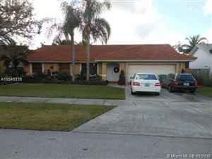 Photo of 15014 SW 168th Ter, Miami, FL 33187 (MLS # A10541111)