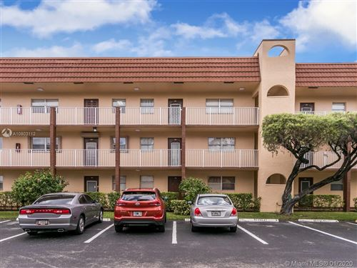 Photo of 2711 N Pine Island Rd #104, Sunrise, FL 33322 (MLS # A10803112)