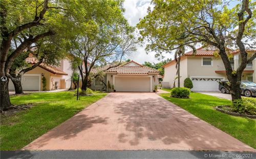 Photo of 10387 NW 43rd Ter, Doral, FL 33178 (MLS # A11042115)