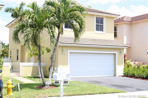 Photo of 6968 SW 148th Ln, Davie, FL 33331 (MLS # A11042120)