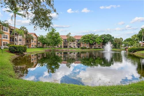 Photo of 8761 Wiles Rd #301, Coral Springs, FL 33067 (MLS # A10876122)