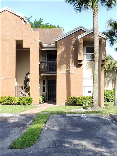 Photo of 685 SW 113th Way #685, Pembroke Pines, FL 33025 (MLS # A10889122)