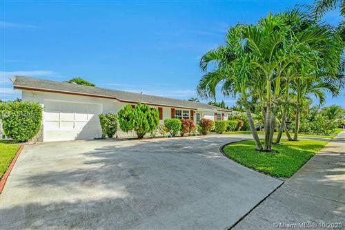 Photo of 428 Alemeda Dr, Palm Springs, FL 33461 (MLS # A10943122)