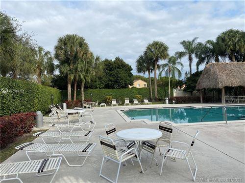 Photo of 10871 NW 8th St, Pembroke Pines, FL 33026 (MLS # A10984122)