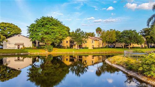Photo of 3833 Cocoplum Cir #3593, Coconut Creek, FL 33063 (MLS # A11030123)