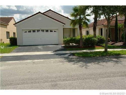 Photo of 564 Talavera Rd, Weston, FL 33326 (MLS # A11078124)