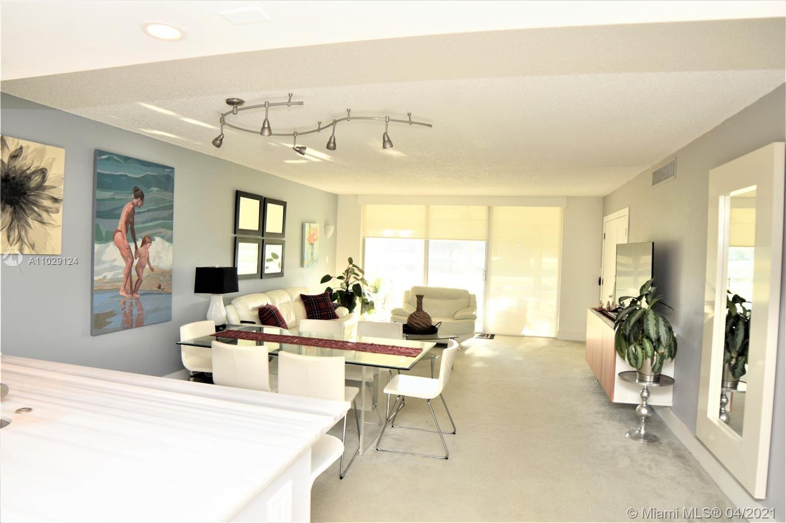 Photo of 802 Cypress Blvd #101B, Pompano Beach, FL 33069 (MLS # A11029124)