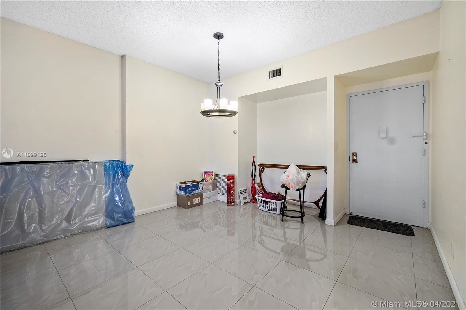 Photo of 4330 Hillcrest Dr #112, Hollywood, FL 33021 (MLS # A11029125)