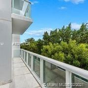 Photo of 100 S Pointe Dr #TH-14, Miami Beach, FL 33139 (MLS # A10969126)