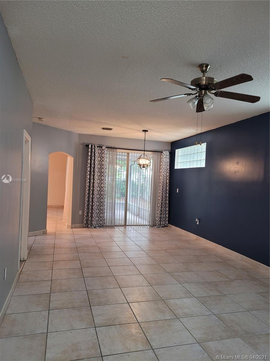 Photo of 4055 Tree Tops Rd #4055, Cooper City, FL 33026 (MLS # A11022126)